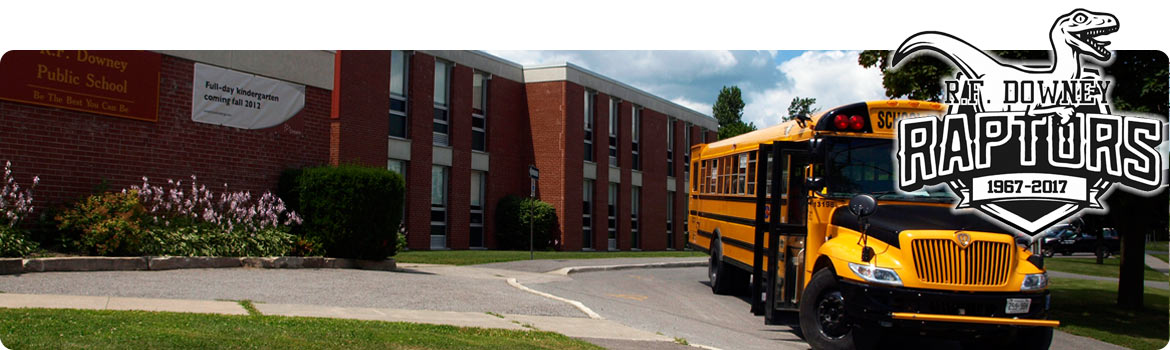 This is a picture of the front of our school with a school bus parked in the driveway.